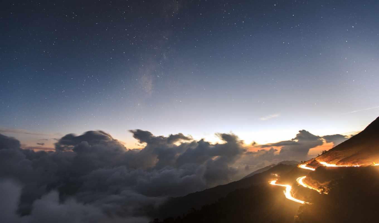 облака, вечер, вид, холмы, огни, дорога, звезды,