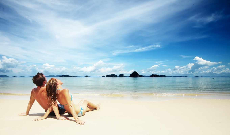 он и она, пляж, море, купальники, небо, горы, прибой