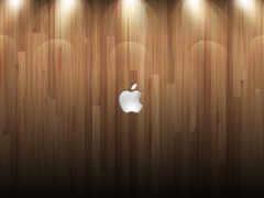apple на блестящем паркете с подсветкой