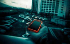 оранжевый смартфон - фотоманипуляция