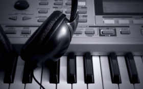 black headphones on synthesizer