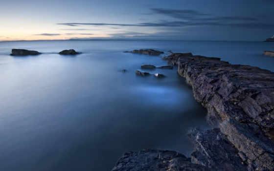 тучи, небо, штиль, вода, Море, катер, оранжевый, гладь, синева, камни, вдали