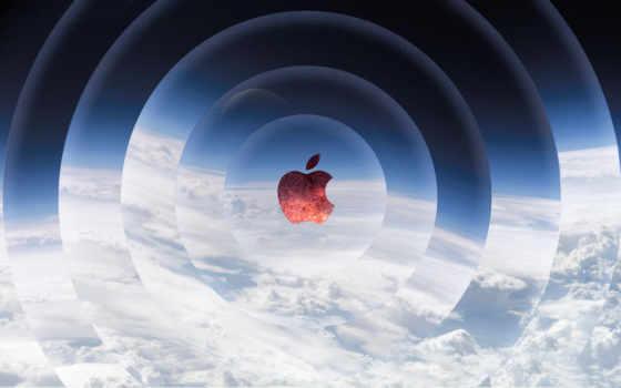 красный apple и отфотошопленные облака