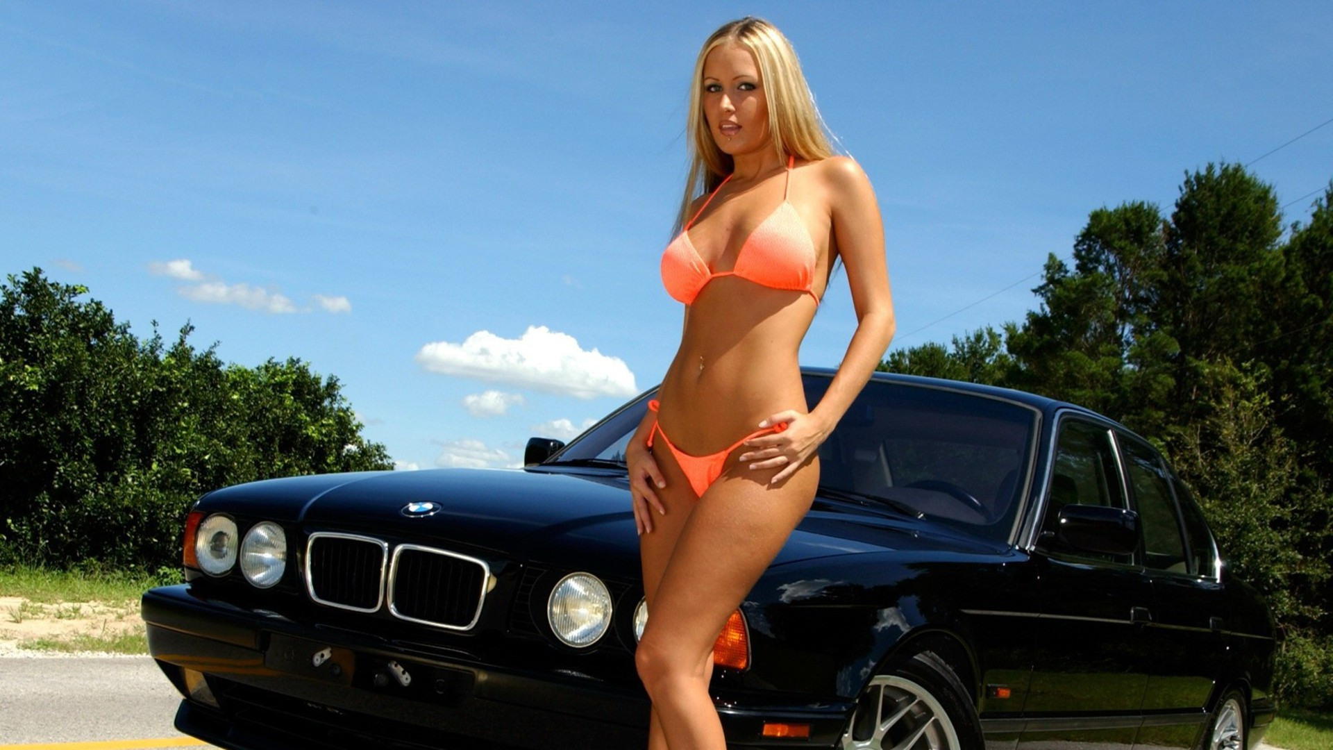 two slutty chicks are being banged next to the car  157528