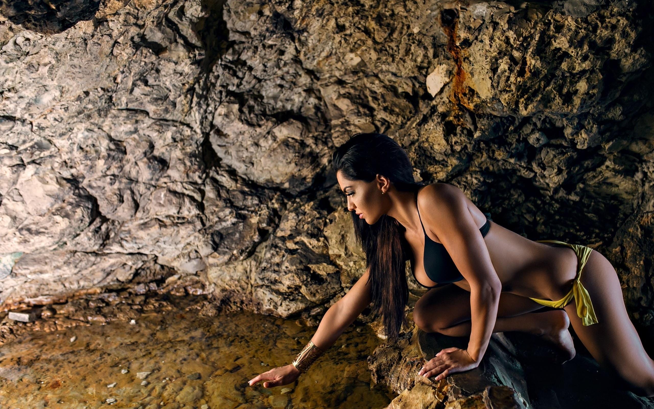 Happy woman dancing in waterfall stock footage photo